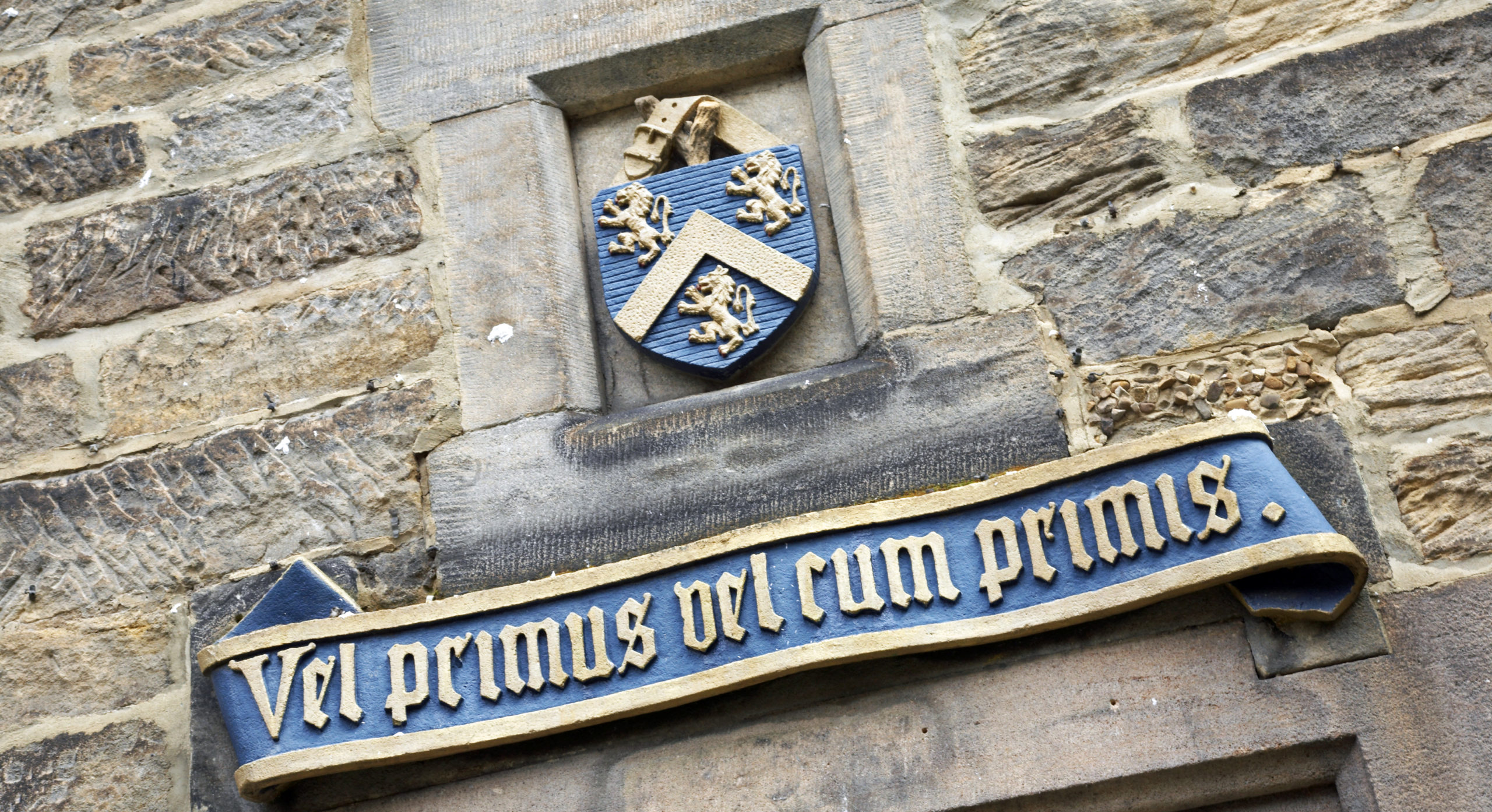 The motto of Hatfield College, Durham University - 'Vel Primus Vel Cum Primus' - above B Stairs doorway
